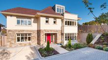 The exterior of Ellington is part-clad in Dalkey granite and one of three 'executive' homes on the site.