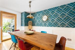 The dining area of No2 Wavecrest in Greystones features doors to the back garden and is connected to the open-plan kitchen/sunroom