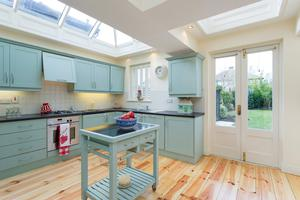 The kitchen has skylights and double doors which lead to the garden.