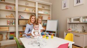 Teacher and Instagrammar Lorna Pringle with Emilia and Harry in the playroom. She pimped up the plain shelving with beading, cornicing and skirting and she also upcycled the play kitchen. Photo: David Conachy