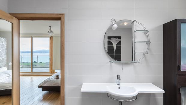 The styled bathroom off the master bed chamber