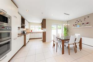 The L-shaped kitchen and dining room lead to the garden