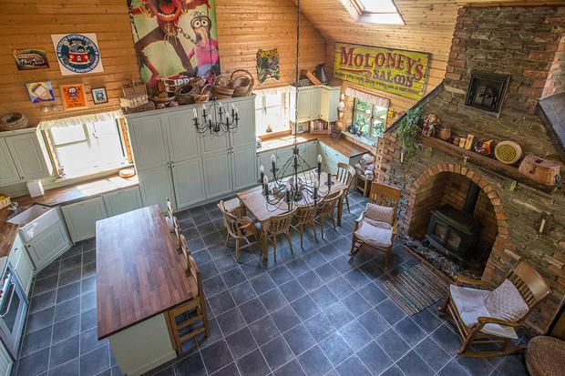 A stone chimney breast dominates the kitchen and dining room