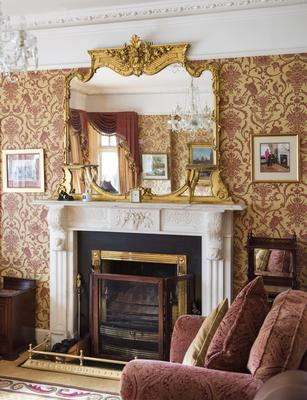 An ornate fireplace in one of the reception rooms