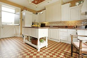 A huge traditional kitchen with period-style floor tiles