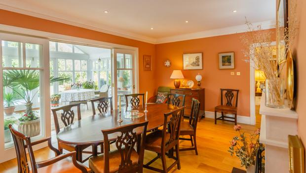 The formal dining room has an open fireplace
