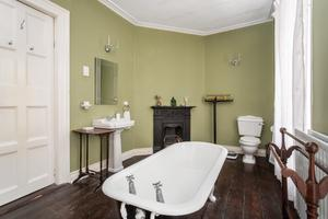 A free-standing bath in one of the bathrooms