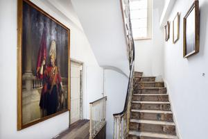 The portrait in the hall is of Sir James Crichton-Browne in ceremonial dress. He is one of Charles's ancestors on his mother's side. His title was that of Chancellor's Visitor on Nervous Diseases and apparently his ideas on treating people in asylums informed the following generation of psychiatrists