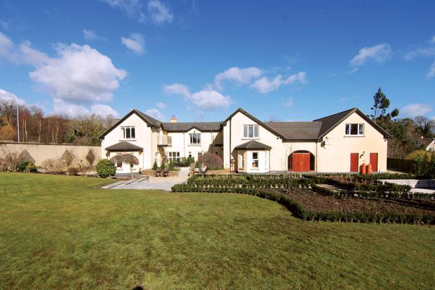 The six-bedroom property includes a central courtyard and an adjoining double garage.