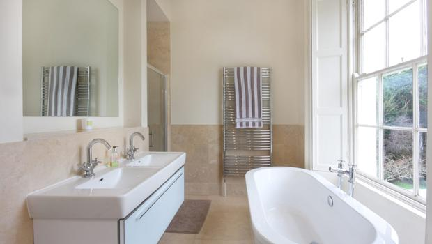 The main bathroom enjoys the grand proportions afforded by this period home