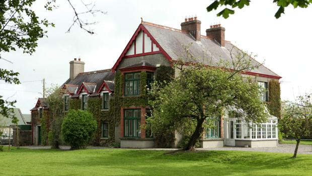 The quaint but elegant house has many period features,with fireplaces inmost rooms