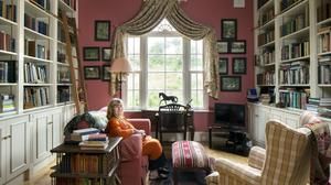 """Maria Ines Dawnay in her library. The sculpture of the horse is just one of many equine motifs in the house because of Hugh's passion for polo. """"He once offered me a horse and I asked, 'Do you really want me to ride?' He said, 'Yes', so I said, 'Give me your best horse'. He never mentioned it again,"""" she says"""