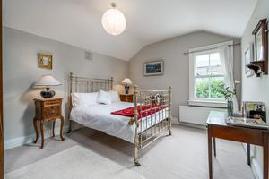 The showstopper antique bed and tall lockers in the master bedroom of No3 Sarsfield Street in Phibsborough, Dublin 7