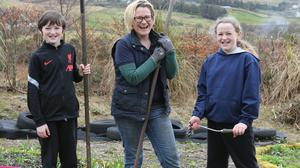 Joanne Butler with two of her children, Lennon and Bethany, at OURganic Gardens in Gortahork, Co Donegal. Photo: Lorcan Doherty