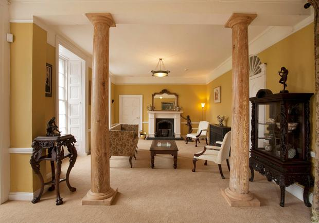 Knockabbey Castle's drawing room with pitch pine pillars