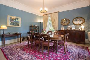 The blue-painted front dining room