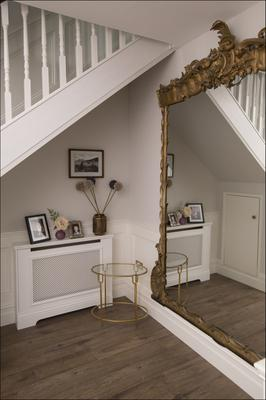Broadcaster Susan Keogh sorted an awkward corner in her L-shaped hallway by adding this enormous gilt mirror
