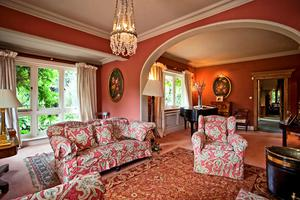 The living room with views of the lawned garden.