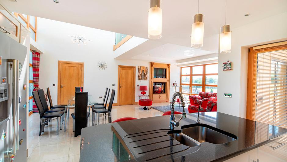 The open plan kitchen/dining/living area