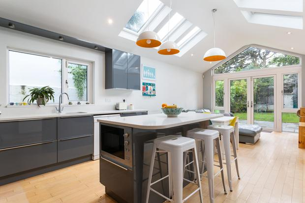 The open plan kitchen / dining / living room with peaked roof and velux windows