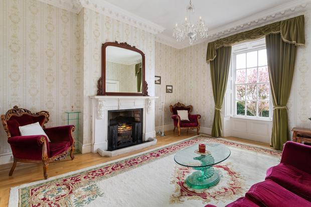 The main reception room features what is believed to be a Robert Adam fireplace