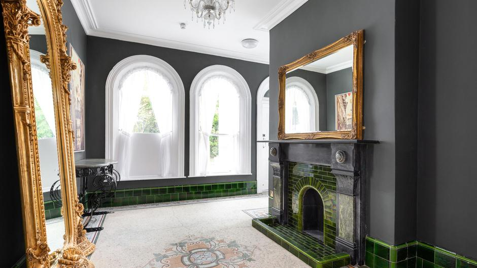 Living room with mosaic tiled floor and period chimney piece