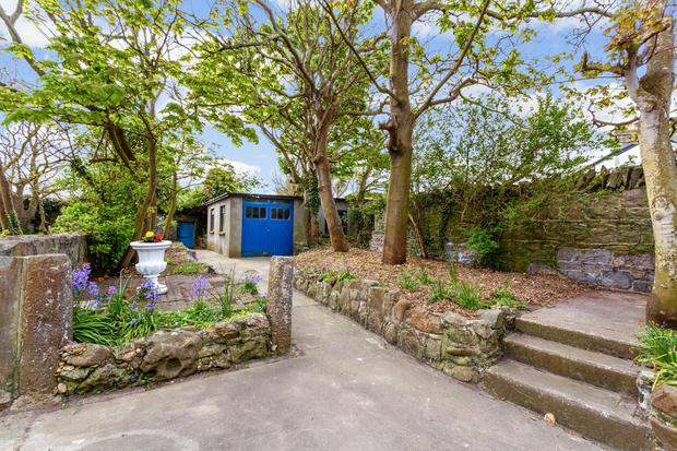 The gardens and grounds extend to half an acre with sea views on both side
