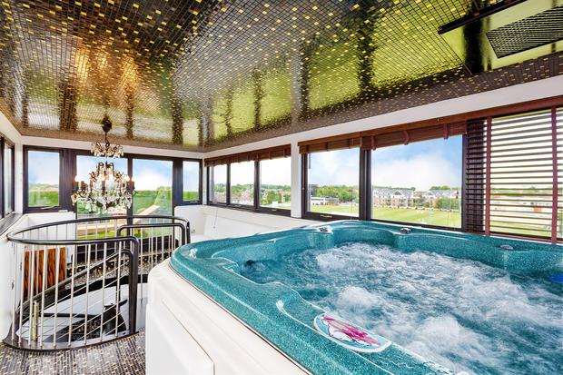 The hot tub room with gold-lined ceiling