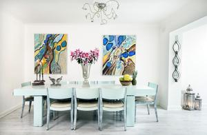 Darina Ni Chuinneagain-Donnelly enlivened her dining area by painting the large table in duck egg blue. The paintings by well known Dutch artist Jean Nies add terrific pops of colour