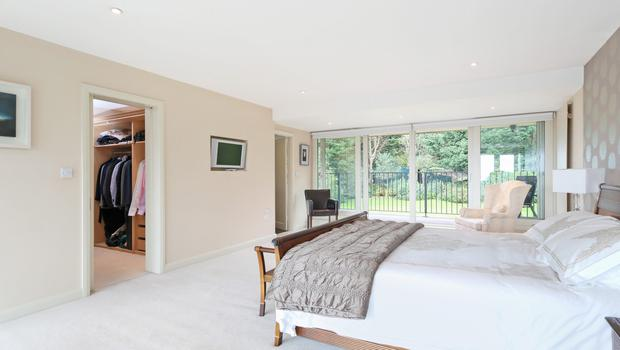 Farnham Hill bedroom, complete with large walk-in wardrobe.