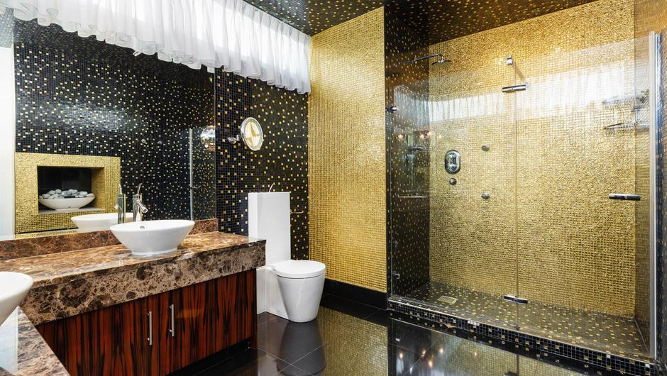 The penthouse shower room with 14-carat gold detailing