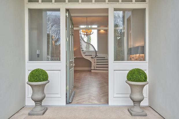 The entrance hall and bespoke staircase at The Brambles, Malahide, Co Dublin