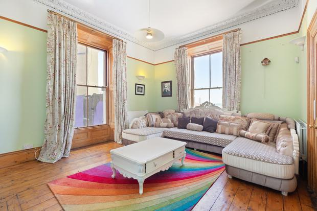 One of the reception rooms with colourful rug