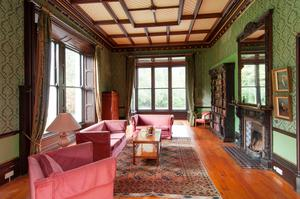 The drawing room with its dark timber features in Wicklow