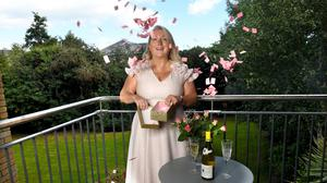 Anne Marie Sparks on the balcony of the apartment she is raffling in Co Wicklow. Photo: Bryan Meade