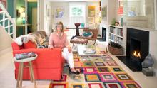 Trisha Younge in the sitting area of her open plan downstairs ground floor. Like the rest of the house, it's full of colour, especially in the use of her paintings.