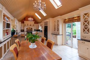 The house has a large, rectangular double height kitchen/ breakfast room located in a wing