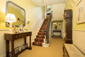Entrance hall with grandfather clock