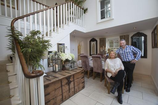 Shirley O'Donohue and her husband John Connolly in the dining area of their converted stonehouse in North Dublin. This area was originally part of the garden - John ,who trained as a carpenter before becoming a property developer designed and built the stairs himself.