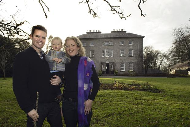 Simon O'Hara and his partner Christina McCauley with their son, Finn, outside Coopershill, the O'Hara family home since the mid-18th Century. Simon's parents now live in a modern house on the estate