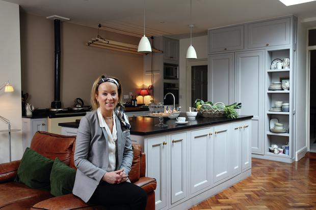 Nikki in her recently extended kitchen, designed by Studio Red. 'The architects were amazing. They only extended it by two-and-a-half feet, yet it made such a difference.' The features include her beloved Aga and the Sheila Maid for drying clothes