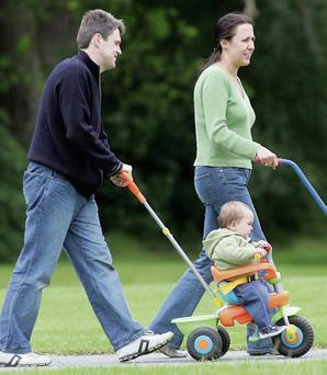 A family enjoying a stroll in Marlay Park in D16