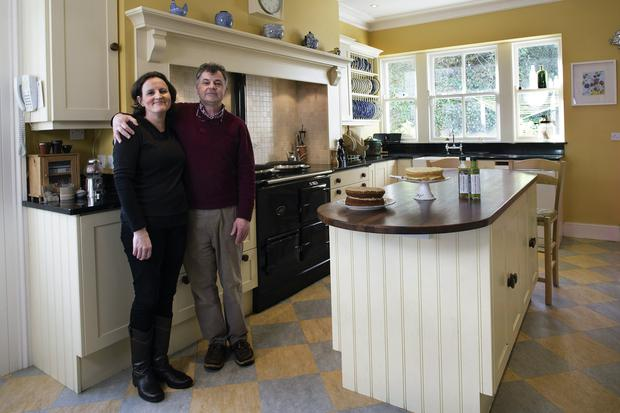 David and Berna Williams in the kitchen of Berna's former family home, which she and David moved into when her parents built a modern house on the site. The house dates from 1872, and Berna's grandfather bought it in 1929, when her mother was two. The country-style cream units were installed by Gerard O'Rourke of Russborough Kitchens