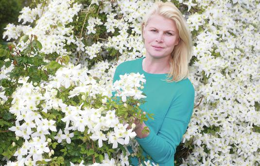 Marie Staunton surrounded by clematis. Photo: Ronan Temple Lang.