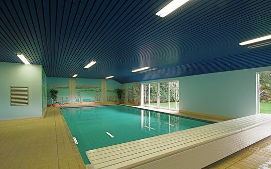 Relax in your own indoor swimming pool at this property in Carrigfern