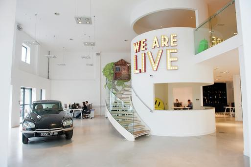 """""""People often ask us about the huge 'WE ARE LIVE' marquee sign on the stairs. For us it's a mission statement — we believe live experiences, like experiential product sampling and corporate events, are the most powerful way to influence consumer and employee behaviour."""""""