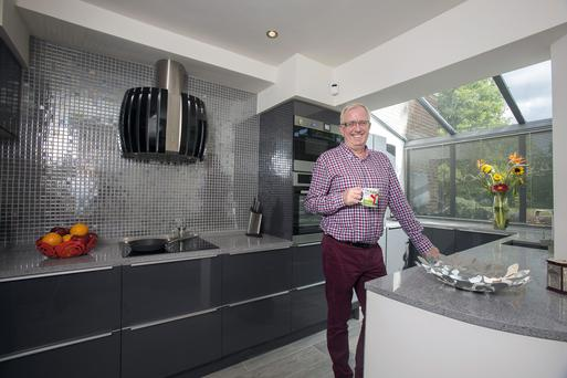 Publicist/actor Rory Cowan in his newly extended kitchen. The units are from Concept Kitchens and the silver wall tiles are from TileStyle