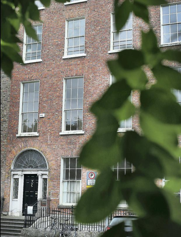 An Irish financier in the US has splashed out over €2m to buy the former HQ of bankrupt lawyer Brian O'Donnell on Dublin's Merrion Square