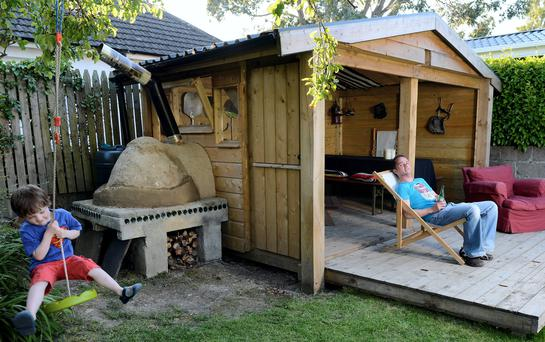 David Leech with his pizza barn shed and son Archie. Photo: Bryan Meade