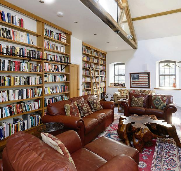 The library has a vaulted ceiling, fitted oak bookshelves and measure 33ft by 16ft.